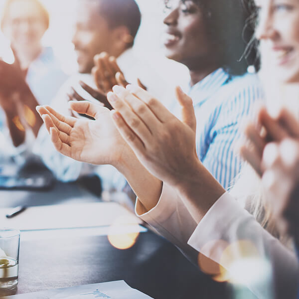 different affiliate members clapping in meeting